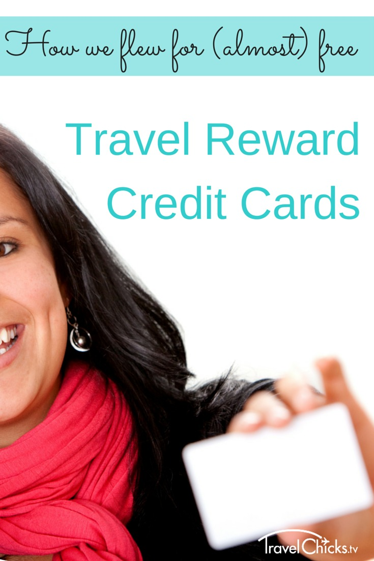 picture of girl holding travel reward credit card